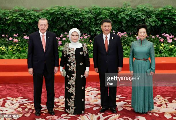 Chinese President Xi Jinping and wife Peng Liyuan welcome Turkish President Recep Tayyip Erdogan and his wife Emine at the welcoming banquet for the...