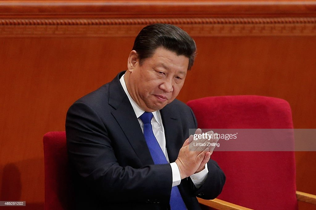 Chinese President <a gi-track='captionPersonalityLinkClicked' href=/galleries/search?phrase=Xi+Jinping&family=editorial&specificpeople=2598986 ng-click='$event.stopPropagation()'>Xi Jinping</a> applauds during the opening of the 3rd Session of the 12th National People's Congress at the Great Hall of the People on March 5, 2015 in Beijing, China. The government work report presented: the main targets of economic and social development; a projected 2015 GDP growth of about 7 percent; and consumer prices rising about 3 percent.