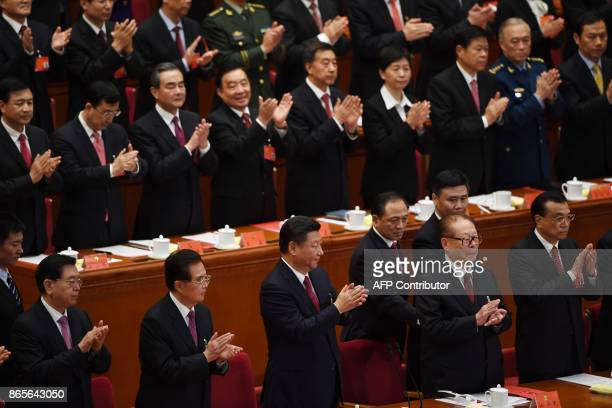 Chinese President Xi Jinping applauds with former presidents Hu Jintao and Jiang Zemin Premier Li Keqiang and National People's Congress Chairman...