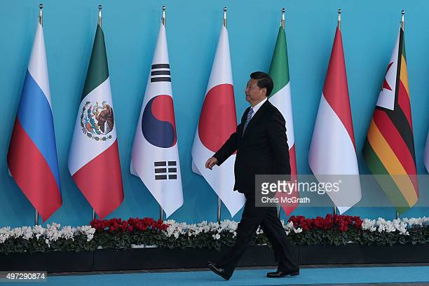Chinese President Xi Jinping arrives during the official welcome ceremony on day one of the G20 Turkey Leaders Summit on November 15 2015 in Antalya...