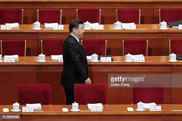 Chinese President Xi Jinping arrives for the opening ceremony of the National People's Congress in the Great Hall of the People on March 5 2016 in...