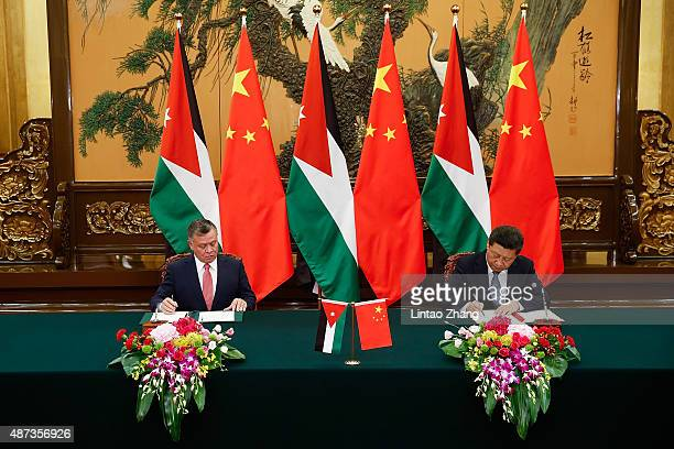 Chinese President Xi Jinping attends a signing ceremony with King of Jordan Abdullah II at The Great Hall Of The People on September 9 2015 in...
