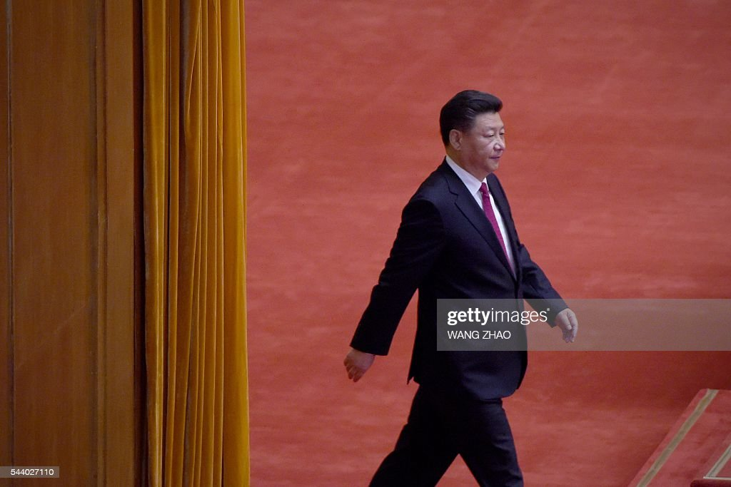Chinese President Xi Jinping attends the celebration ceremony of the 95th Anniversary of the Founding of the Communist Party of China at the Great Hall of the People in Beijing on July 1, 2016. China's Communist Party take the ruling organisation's membership to almost 88 million and the anniversary of the Party's founding falls on July 1. / AFP / WANG