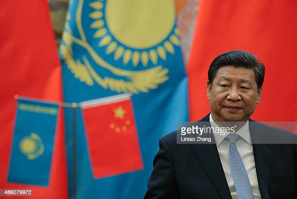 Chinese President Xi Jinping attends the signing ceremony during a meeting with Kazakhstan President Nursultan Nazarbayev at the Great Hall of the...