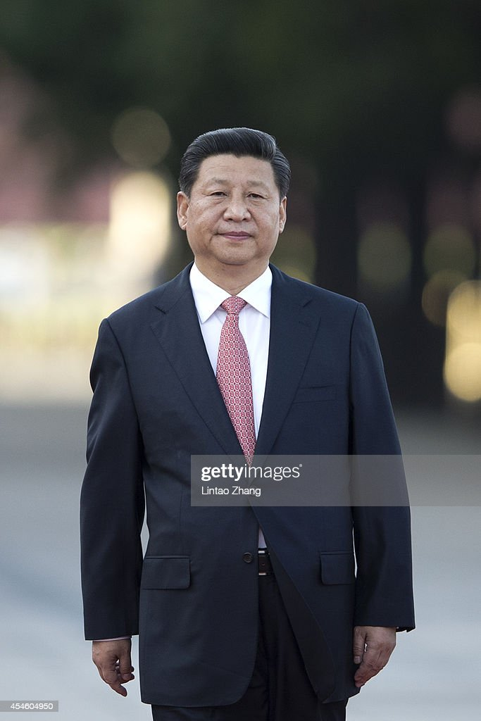 Chinese President <a gi-track='captionPersonalityLinkClicked' href=/galleries/search?phrase=Xi+Jinping&family=editorial&specificpeople=2598986 ng-click='$event.stopPropagation()'>Xi Jinping</a> attends welcoming ceremony for Malaysia's Yang di-Pertuan Agong Tuanku Alhaj Abdul Halim Mu'adzam Shah outside the Great Hall of the People on September 4, 2014 in Beijing, China. The invitation of President <a gi-track='captionPersonalityLinkClicked' href=/galleries/search?phrase=Xi+Jinping&family=editorial&specificpeople=2598986 ng-click='$event.stopPropagation()'>Xi Jinping</a>, Sultan Tuanku Alhaj Abdul Halim Mu'Adzam Shah of Malaysia will pay a state visit to China from September 3rd to 8th.