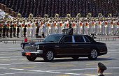 Chinese President Xi Jinping begins a review of troops from a car during a military parade at Tiananmen Square in Beijing on September 3 to mark the...