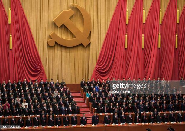Chinese President Xi Jinping bottom center and senior members of the government stand during the national anthem prior to the opening session of the...