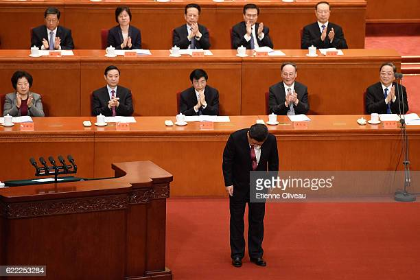Chinese President Xi Jinping bows to the assembly after his speech marking the 150th anniversary of the birth of Sun Yatsen at The Great Hall Of The...