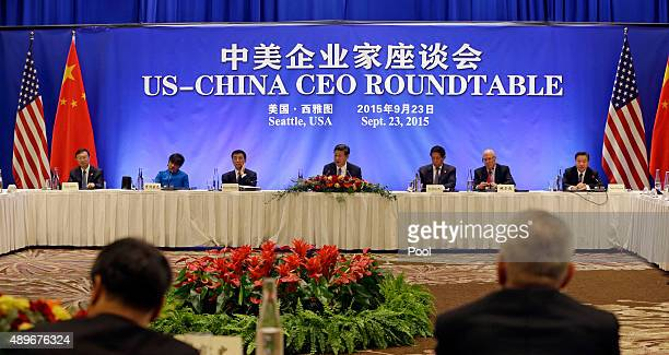 Chinese President Xi Jinping center addresses a USChina business roundtable comprised of US and Chinese CEOs on September 23 in Seattle Washington...