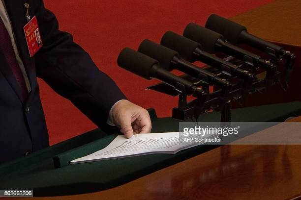 Chinese President Xi Jinping delivers a speech at the opening session of the Chinese Communist Party's Congress at the Great Hall of the People in...