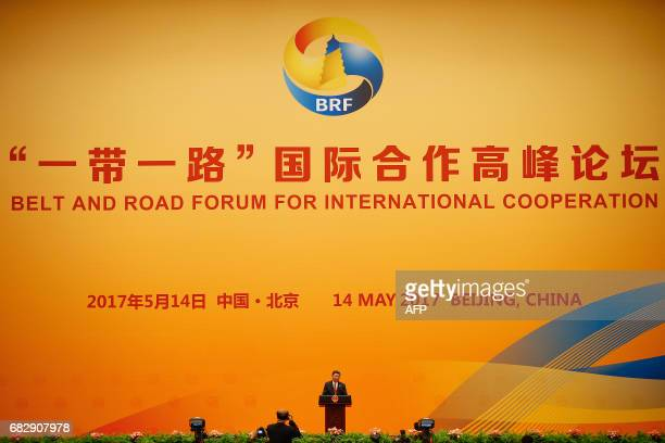 Chinese President Xi Jinping delivers his speech during the welcoming banquet for the Belt and Road Forum at the Great Hall of the People in Beijing...