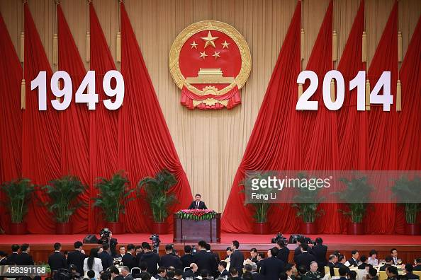 Chinese President Xi Jinping delivers his speech for the National Day reception marking the 65th anniversary of the founding of the People's Republic...