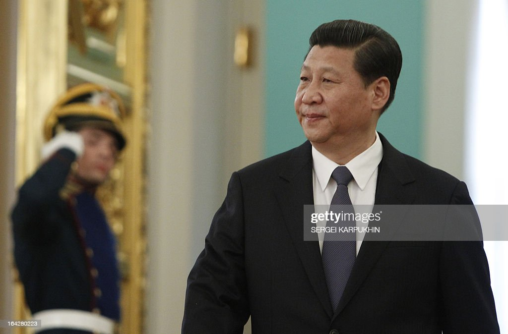 Chinese President Xi Jinping enters a hall in the Grand Kremlin Palace in Moscow, on March 22, 2013, before a to meeting with his Russian counterpart Vladimir Putin. Xi Jinping arrived today in Moscow on his first foreign trip, to cement ties between the two countries by inking a raft of energy and investment accords.