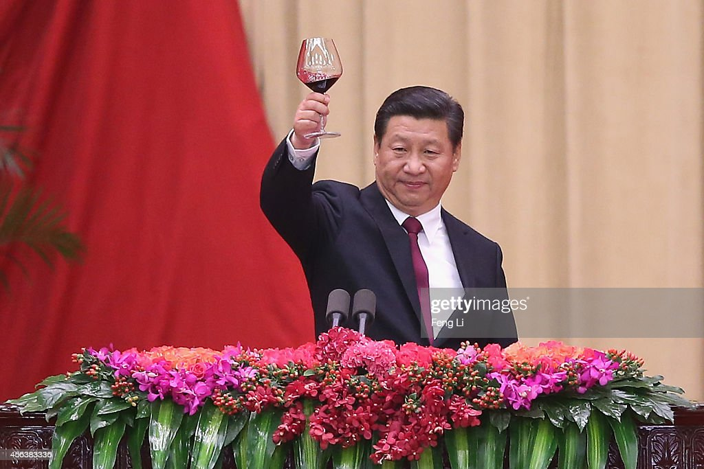 Chinese President Xi Jinping gives a toast during the National Day reception marking the 65th anniversary of the founding of the People's Republic of China at The Great Hall Of The People on September 30, 2014 in Beijing, China. China celebrates its 65th founding anniversary on October 1, which marks the beginning of the Golden Week National Day holidays.