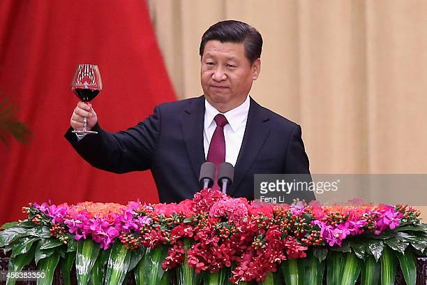Chinese President Xi Jinping gives a toast during the National Day reception marking the 65th anniversary of the founding of the People's Republic of...