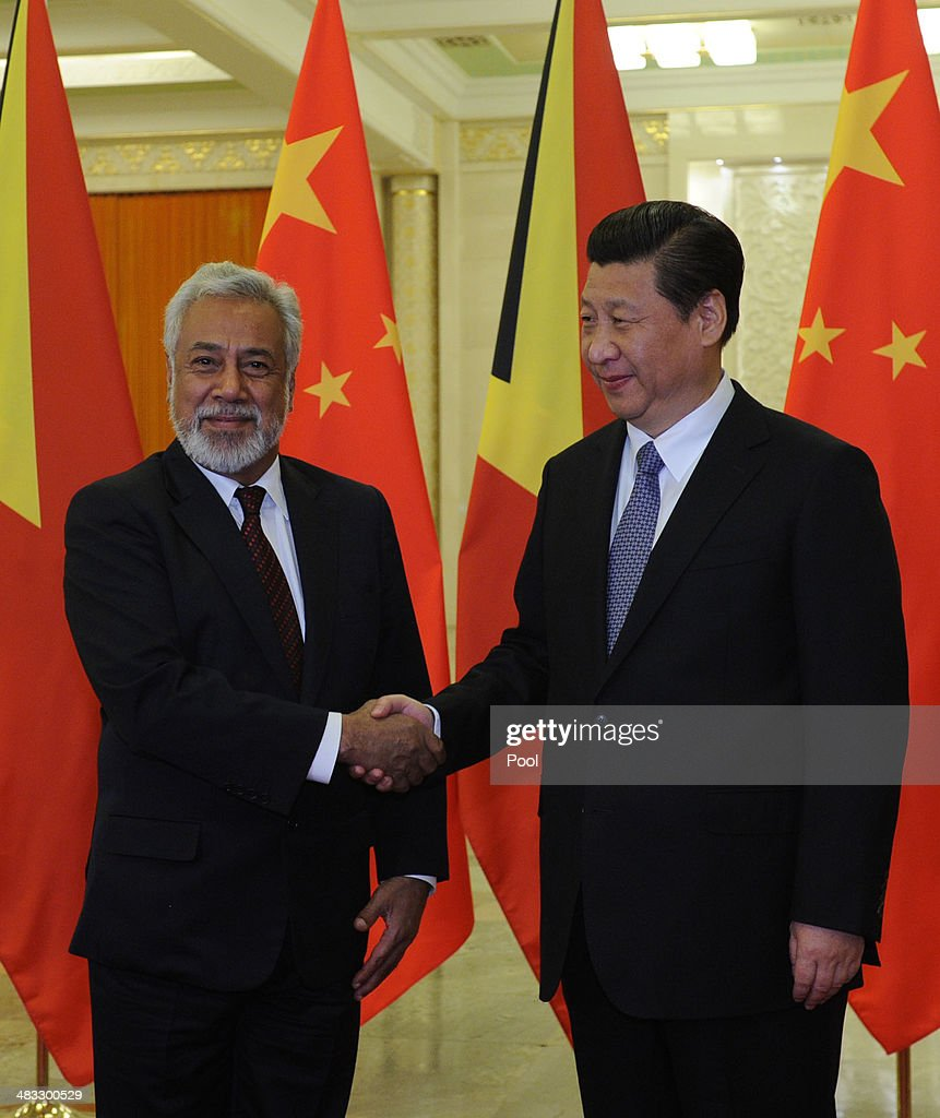 Chinese President <a gi-track='captionPersonalityLinkClicked' href=/galleries/search?phrase=Xi+Jinping&family=editorial&specificpeople=2598986 ng-click='$event.stopPropagation()'>Xi Jinping</a> (R) greets East Timor Prime Minister <a gi-track='captionPersonalityLinkClicked' href=/galleries/search?phrase=Xanana+Gusmao&family=editorial&specificpeople=223915 ng-click='$event.stopPropagation()'>Xanana Gusmao</a> before a meeting at the Great Hall of the People April 8, 2014 in Beijing, China. (Photo by Parker Song-Pool/Getty Images).