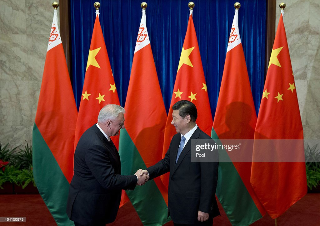 Chinese President <a gi-track='captionPersonalityLinkClicked' href=/galleries/search?phrase=Xi+Jinping&family=editorial&specificpeople=2598986 ng-click='$event.stopPropagation()'>Xi Jinping</a> (R) greets Prime Minister of Belarus Mikhail Myasnikovich ahead of their meeting at the Great Hall of the People on January 21, 2013 in Beijing, China,