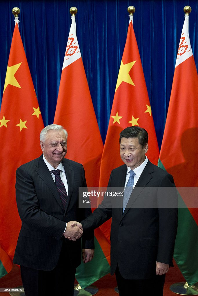Chinese President Xi Jinping (R) greets Prime Minister of Belarus Mikhail Myasnikovich ahead of their meeting at the Great Hall of the People on January 21, 2013 in Beijing, China,