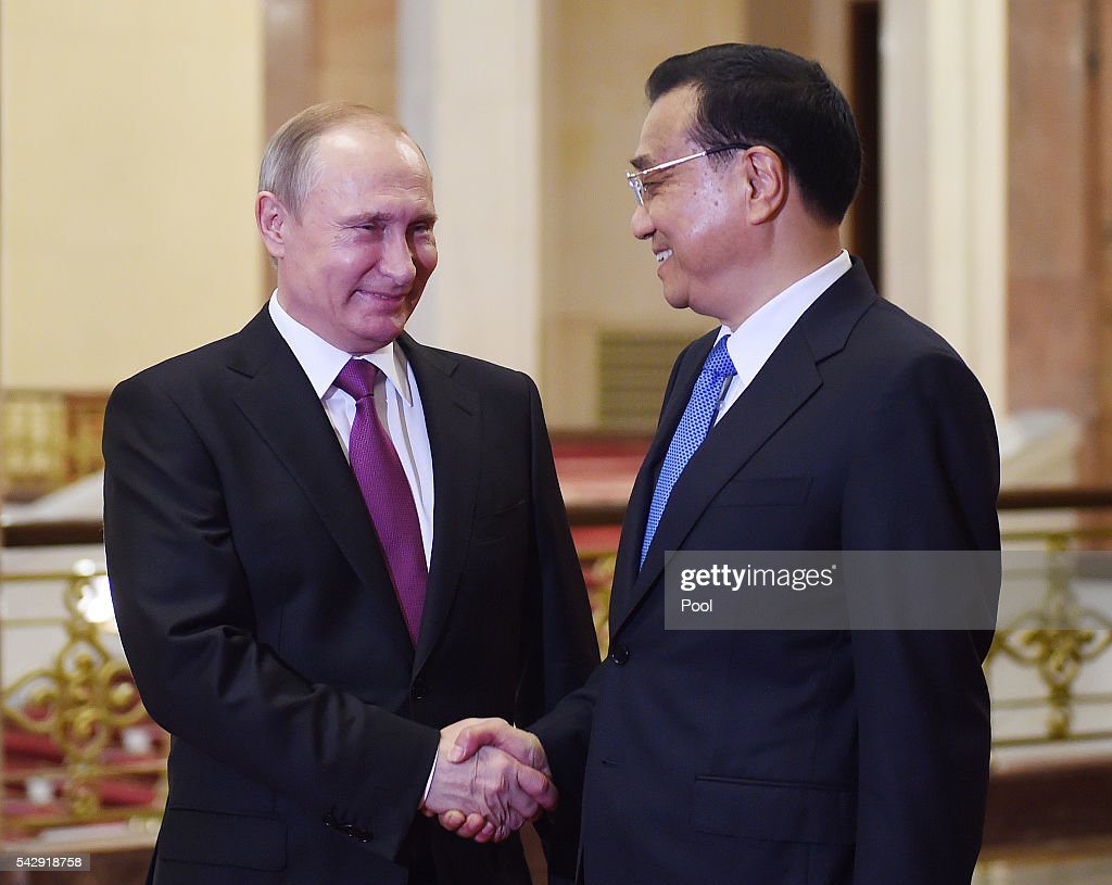Chinese President Xi Jinping (R) greets Russian President Vladimir Putin at the Great Hall of the People on June 25, 2016 in Beijing, China. Russian President Vladimir Putin is in China to discuss more economic and military cooperation between the two countries.