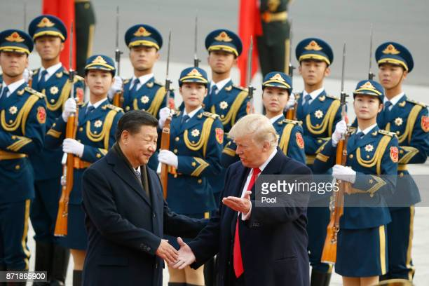Chinese President Xi Jinping greets US President Donald Trump at a welcoming ceremony November 9 2017 in Beijing China Trump is on a 10day trip to...