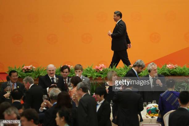 Chinese President Xi Jinping holds cup leaving after he made a toast during a welcome banquet for the Belt and Road Forum at the Great Hall of the...
