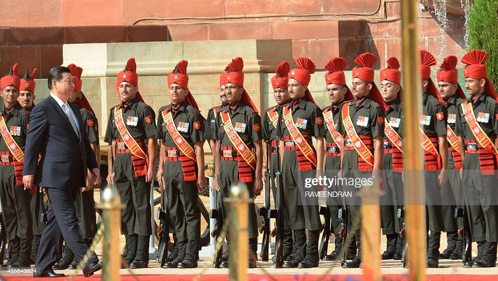 Chinese President Xi Jinping inspects a Guard of Honour during a reception in the Indian capital New Delhi on September 18 2014 India's prime...