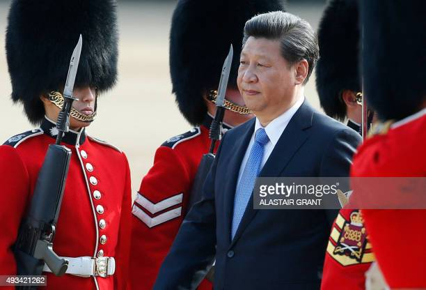 Chinese President Xi Jinping inspects the guard of honour on Horse Guards Parade in central London on October 20 2015 during the ceremonial welcome...