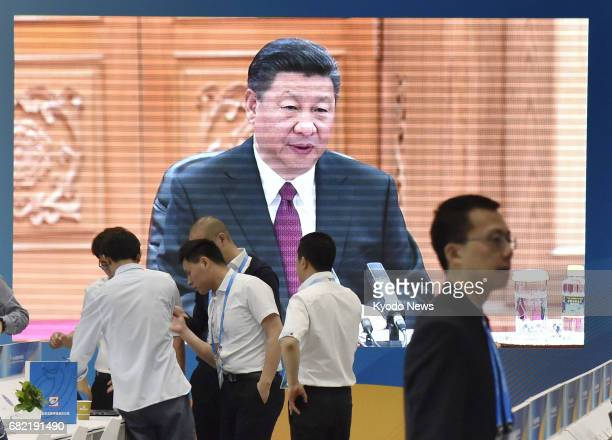 Chinese President Xi Jinping is shown on May 12 2017 on a large screen at a press center in Beijing for an international conference on the 'One Belt...