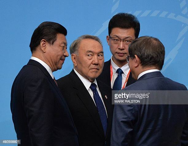 Chinese President Xi Jinping Kazakhstan President Nursultan Nazarbayev and Turkish Foreign Minister Ahmet Davutoglu gather the closing press...