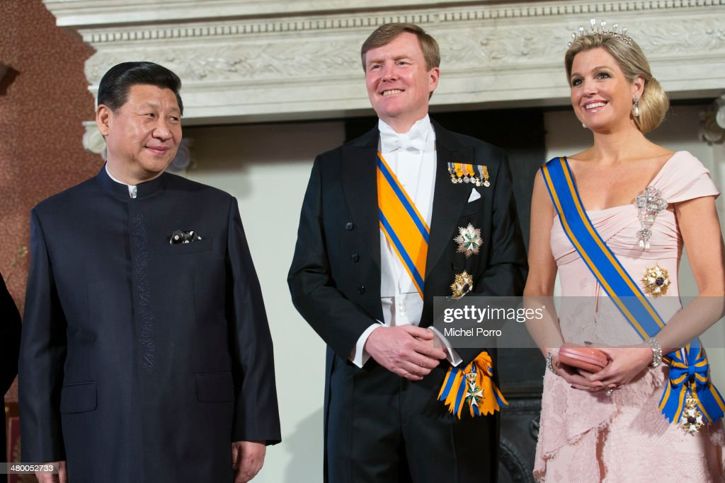 Chinese President Xi Jinping, King Willem-Alexander of The Netherlands and Queen Maxima of The Netherlands have the official photo taken at the Royal Palace upon the arrival of Chinese President Xi Jinping on March 22, 2014 in Amsterdam, Netherlands. Xi Jinping is on a two-day state visit to the Netherlands ahead of the 2014 Nuclear Security Summit (NSS) in The Hague, which will be held on March 24-25.
