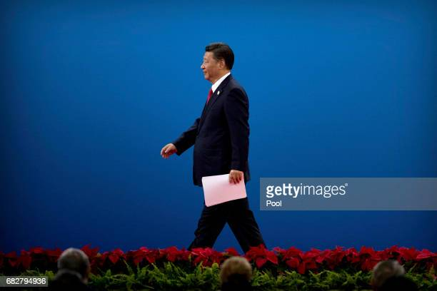 Chinese President Xi Jinping leaves the stage after speaking during the opening ceremony of the Belt and Road Forum at the China National Convention...