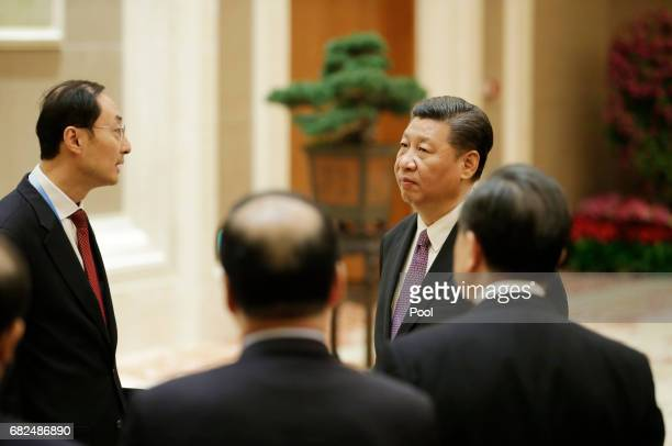 Chinese President Xi Jinping listens to Chinese senior officials before a meeting with Pakistani Prime Minister Nawaz Sharif ahead of the Belt and...