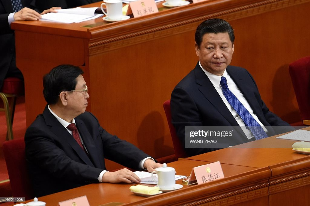 Chinese President Xi Jinping (R) looks at Chairman of the Standing Committee of China's National People's Congress (NPC), Zhang Dejiang (L) at the opening session of the Chinese People's Political Consultative Conference (CPPCC) at the Great Hall of the People in Beijing on March 3, 2015. Thousands of delegates from across China and the Chinese leadership will gather for its annual legislature meetings from March 3 in Beijing.