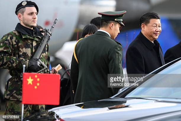 Chinese president Xi Jinping looks on as he leaves the tarmac at the end of the welcome ceremony upon his arrival for a state visit to Switzerland on...