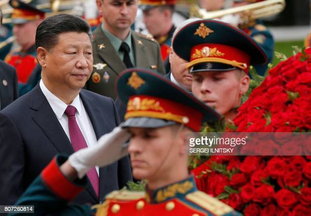 Chinese President Xi Jinping looks on during a wreath laying ceremony at the Tomb of the Unknown Soldier on July 4 2017 near the Kremlin in Moscow as...