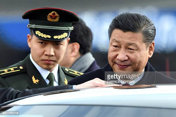 Chinese president Xi Jinping looks on leaving the tarmac after the welcome ceremony at the opening of a state visit on January 15 2017 at Zurich...