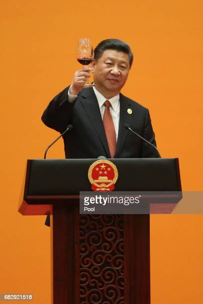 Chinese President Xi Jinping makes a toast during a welcome banquet for the Belt and Road Forum at the Great Hall of the People in Beijing China 14...