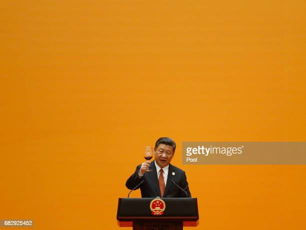Chinese President Xi Jinping makes a toast during the welcoming banquet for the Belt and Road Forum at the Great Hall of the People in Beijing China...