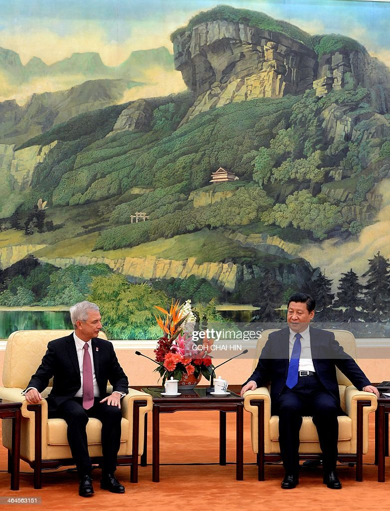 Chinese President Xi Jinping (R) makes his opening remarks during a meeting with Claude Bartolone, President of the French National Assembly, at the Great Hall of the People in Beijing on January 23, 2014. Bartolone is in China as part of the celebrations marking the 50-year anniversary of France establishing full diplomatic ties with Communist China on January 27, when in 1964, France broke ranks with the US to open ties with the then-government of Mao Zedong -- a decision that paved the way for China to gain global recognition. AFP PHOTO/GOH CHAI HIN