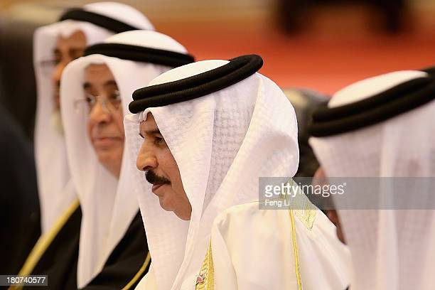 Chinese President Xi Jinping meets King Hamad Bin Isa Al Khalifa of Bahrain after a welcoming ceremony at the Great Hall of People on September 16...