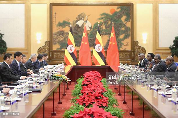 Chinese President Xi Jinping meets Ugandan President Yoweri Kaguta Museveni at the Great Hall of the People on March 31 2015 in Beijing China