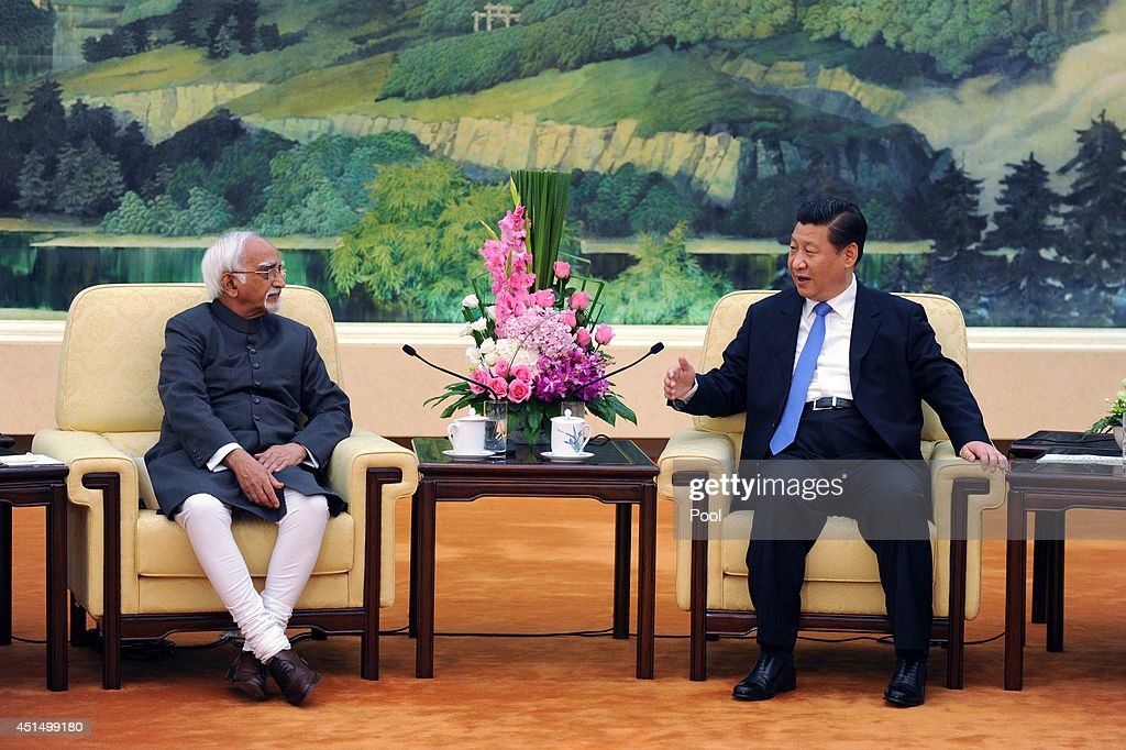 Chinese President <a gi-track='captionPersonalityLinkClicked' href=/galleries/search?phrase=Xi+Jinping&family=editorial&specificpeople=2598986 ng-click='$event.stopPropagation()'>Xi Jinping</a> (R) meets with Indian Vice President Shri Mohammad Hamid Ansari (L) at the Great Hall of the People in Beijing on June 30, 2014 in Beijing, China. Shri Mohammad Hamid Ansari is on a visit to China from June 26 - 30.