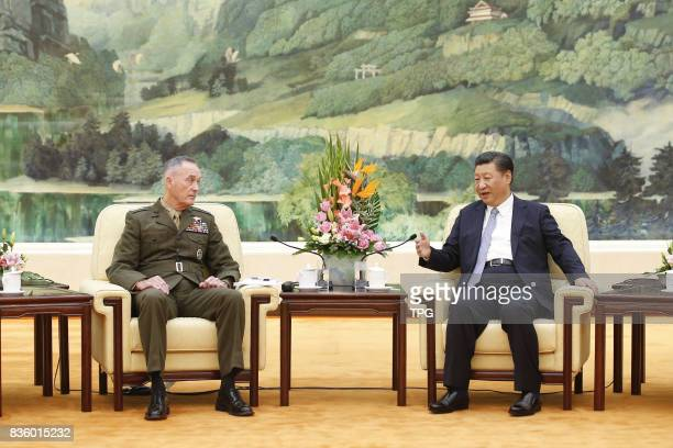 Chinese President Xi Jinping meets with visiting Chairman of the US Joint Chiefs of Staff Joseph Dunford at the Great Hall of the People in Beijing...