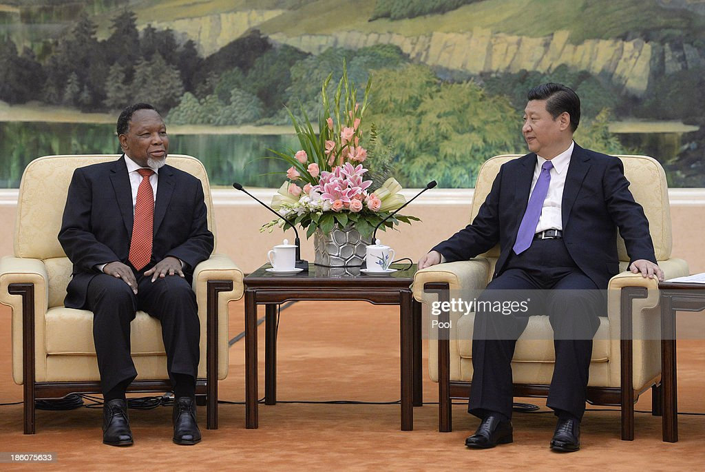 Chinese President Xi Jinping (R) meets with visiting South African Deputy President Kgalema Motlanthe at the Great Hall of the People on October 28, 2013 in Beijing, China.