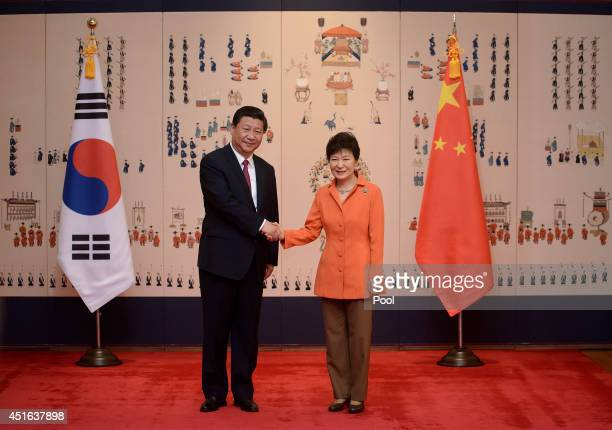 Chinese President Xi Jinping pose with South Korean President Park GeunHye prior to a summit meeting at the presidential Blue House on July 3 2014 in...