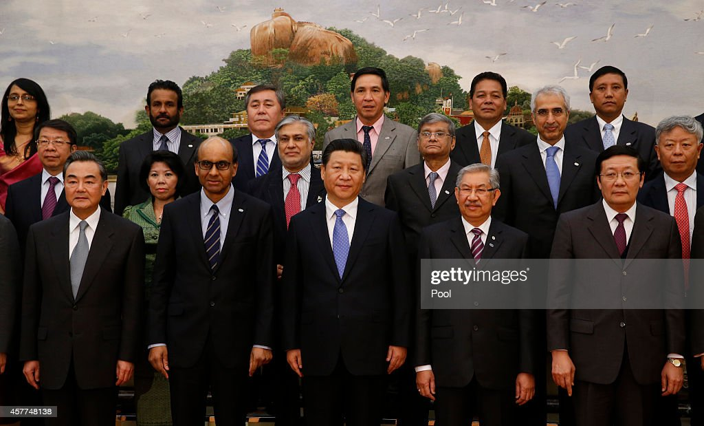 Chinese President Xi Jinping poses at a meeting of reprentatives at the signing ceremony for the Asian Infrastructure Investment Bank at the Great...