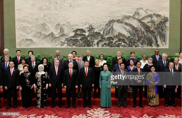 Chinese President Xi Jinping poses next to his wife Peng Liyuan and Russian President Vladimir Putin and delegates and guests at the welcoming...