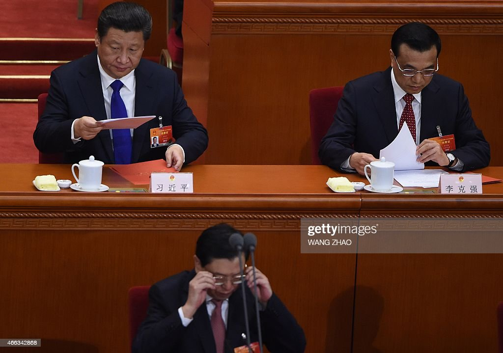 Chinese President Xi Jinping (top L), premier Li Keqiang (top R) and chairman of the Standing Committee of the National People's Congress (NPC) Zhang Dejiang attend the closing of the 3rd Session of the 12th National People's Congress at the Great Hall of the People in Beijing on March 15, 2015. China's Communist Party-controlled legislature, the National People's Congress (NPC), gathers in the capital for the annual show of political theater, with the 'rule of law' high on the agenda.