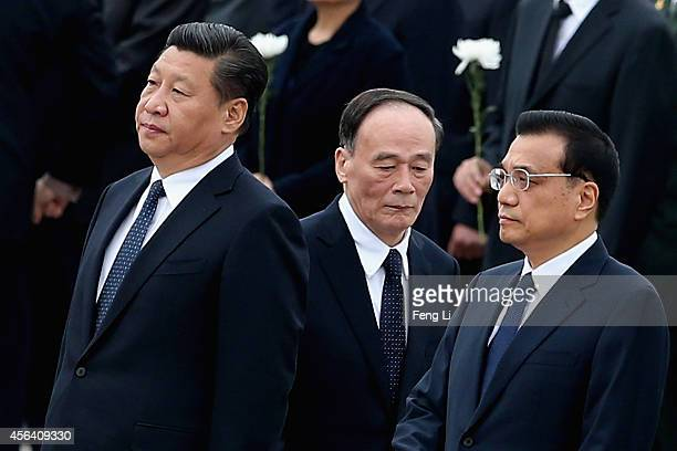 Chinese President Xi Jinping Premier Li Keqiang and Secretary of the Central Commission for Discipline Inspection Wang Qishan arrive the Monument to...