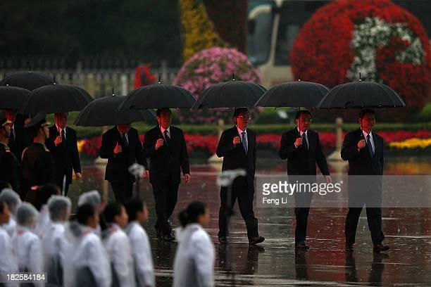 Chinese President Xi Jinping Premier Li Keqiang members of the Politburo Standing Committee Zhang Dejiang Yu Zhengsheng Liu Yunshan Wang Qishan and...